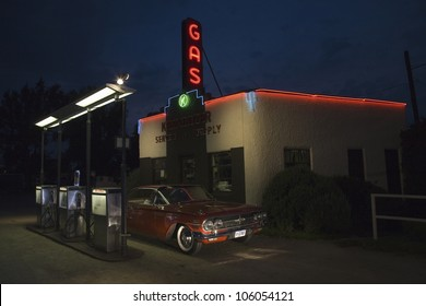 AUGUST 2007 - Neon sign reading Gas and 1960 red Impala Chevrolet at Kensinger Service & Supply historic gas station, on US Highway 30, the Lincoln Highway, Grand Island, Nebraska