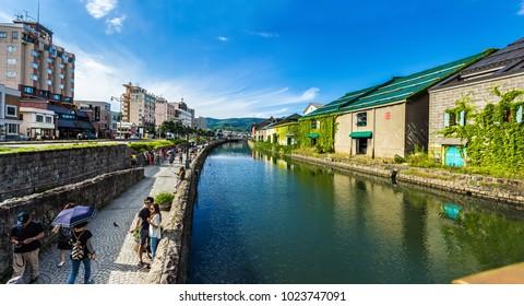 August 2016. Panorama of the Otaru canal. Old sea depots with green plants on walls. Otaru. Hokkaido island.Japan.