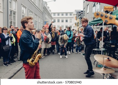 """August 2016, Reykjavik, Iceland.  Jazz band playing to the crowd of people on a street at the day of """"Culture Night"""" of Reykjavik"""