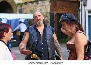 August, 2017, Lincoln, Lincolnshire, United Kingdom. Steampunk Festival at Lincoln Castle. People wearing pseudo-Victorian costumes. The Costume Parade in the streets.