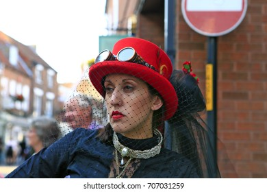 August, 2017, Lincoln, United Kingdom. Steampunk Festival at Lincoln Castle. People wearing pseudo-Victorian costumes. The Costume Parade in the streets.
