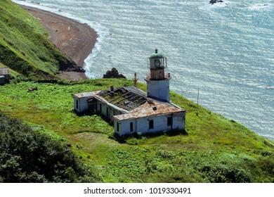 August 2017. The oldest lighthouse on Sakhalin island in Aleksandrovsk-Sakhalinsky town. View on Tatar strait.