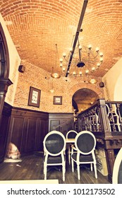 August, 2017. Ukraine, Chernivtsi - Interior of the restaurant, cafe in the old house. The old interior of the restaurant in the city center, red brick, large windows.