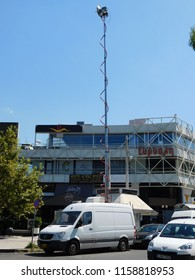 August 2018, Glyfada, Greece. Television outside broadcast van with a telescopic antenna