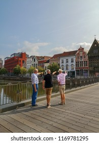 August 2018 - Mechelen, Belgium: People walking on the Kraanbrug admiring the historical houses at the Haverwerf in the city center of Mechelen