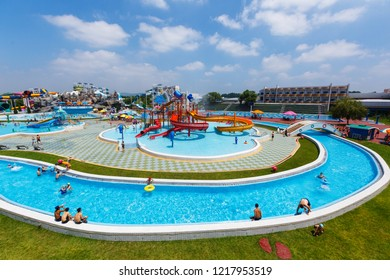 August, 2018, Pyongyang, North Korea - North Koreans rest in the new large water park Munsu. The water park is located near the River Tedon, covers an area of 109,000 square meters. The water park als