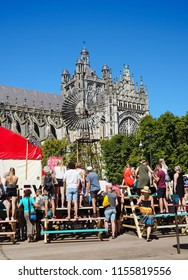 August 2018 - 's-Hertogenbosch, Netherlands: People enjoying the Boulevard street theater festival next to the St. John's Cathedral