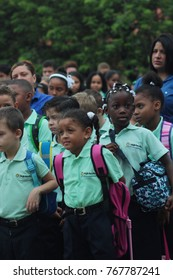August 20,2017, Dominican Republic,city Sosua,a private Protestant school: group of school children, primary class, with teachers, on the school line, the first day of the new school year