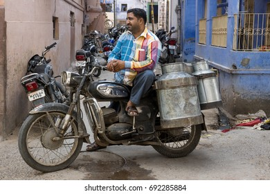 August 20th 2014  Jodhpur Rajasthan India  Milkman transporting milk on two wheeler motor