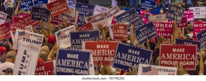 AUGUST 22, 2017, PHOENIX, AZ U.S. Crowds hold signs for President Donald J. Trump at the Phoenix Convention Center
