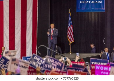 AUGUST 22, 2017, PHOENIX, AZ   U.S. President Donald J. Trump gestures to crowd of supporters at the Phoenix Convention Center during a 2020 Trump rally