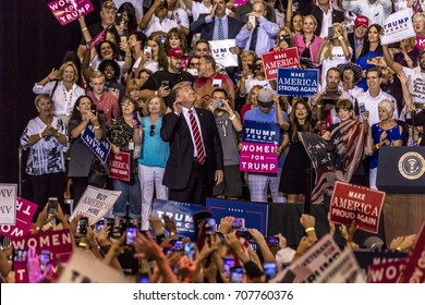 AUGUST 22, 2017, PHOENIX, AZ   U.S. President Donald J. Trump gestures to listen to crowd of supporters at the Phoenix Convention Center during a 2020 Trump rally