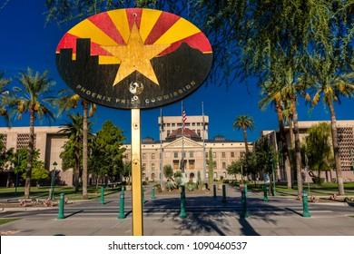 """AUGUST 23, 2017 - PHOENIX ARIZONA - Arizona State Capitol Building at sunrise, Phoenix, Arizona shows """"Arizona State Flag"""""""