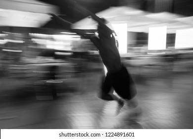 August 25,  2016 barselona   Spain.  Acrobats on main street of  Barselona Evening.  Unrecognizable man.