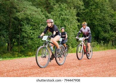 August 26, 2017, Bicycle race Akkesport, Narva, Estonia. Teenage girl participant race rides on he bicycle at high speed. Ahead of an opponent