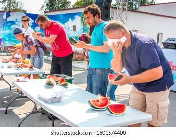 August 26, 2017. Kiev, Ukraine. Watermelon eating contest for a while.  group of people eat watermelon.