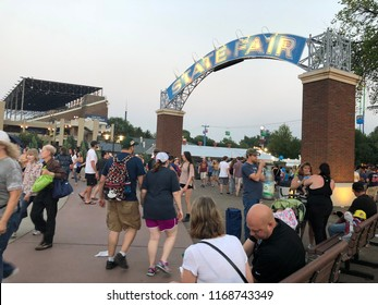 AUGUST 27 2018: MINNEAPOLIS, MN: Crowds of people walk through the gate of the Minnesota State Fair. The 2018 MN State Fair broke several daily attendance records