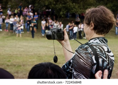 August 28, 2017: A woman shoots a horse on a video camera during a holiday held in Ukraine, Odessa region, August 28, 2017