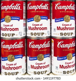 August 29, 2019 Sunnyvale / CA / USA -Close up of tin cans of Campbell's mushroom soup for sale in a supermarket; Campbell's Soup Company was founded in 1869 and now sells products in 120 countries