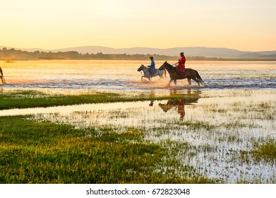 In August 3, 2016 the herdsman urged the horses through the General lake of Hexigten banner of Inner mongolia.