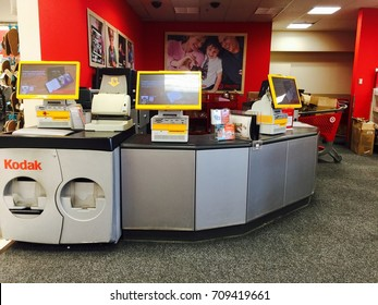 AUGUST 31 2017 - CRYSTAL, MN: Target Photo Center kiosks are unused, and the counter is unmanned. Target retail stores removed all of the one-hour photo centers and placed Kodak photo printing kiosks