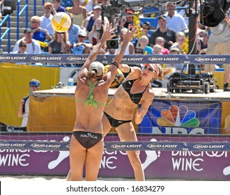 August 31st, 2008--Mason, Ohio.  Kerri Walsh spikes the ball during the finals of an AVP tournament vs. Elaine Youngs and Nicole Branagh.  Walsh was defeated for the first time in over a year