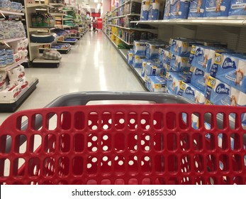 AUGUST 5 2017 - CRYSTAL, MINNESOTA: A red empty Target shopping cart rolls down the paper goods aisle in a Target store