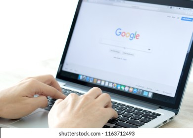 August 5, 2018 Bangkok, Thailand young men use computer laptop internet  looking screen web google is social networking service.he surf the Internet to get information of the world.