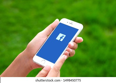August 5, 2019 Bangkok, Thailand young women use smartphone internet  looking screen Facebook is social networking service.he surf the Internet to get information of the world.
