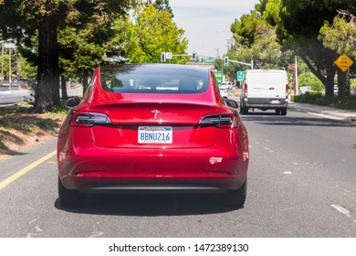 August 5, 2019 Mountain View / CA / USA - Rear view of red Model 3 Tesla driving on a highway in South San Francisco bay area