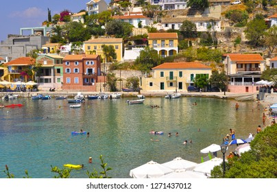 August 5,2013- Assos,  Kefalonia, Greece. Colorful houses and beach view of town.