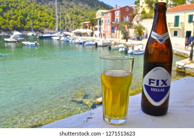 August 5,2013- Assos, Kefalonia, Greece. Drinking beer on a hot day on the island.