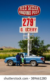 August 6, 2015 - Red Mesa, Arizona, USA: Navajo people stand by their car at Red Mesa Trading Post and Gas Station, Arizona