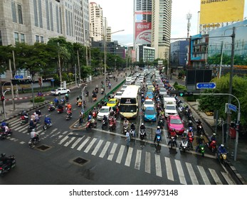 August 6 2018: Bangkok Thailand: The most famous traffic jam scene view from bts skytrain walkway in rainy day of Asoke - Sukhumvit in Bangkok.