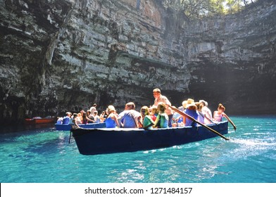 August 6,2013- Melissani Cave, Sami, Kefalonia, Greece. People on boat trip inside the cave.