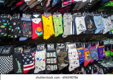 AUGUST 7 2016 - MONTEREY CALIFORNIA: A gift shop in Cannery Row sells colorful novelty socks, popular item with tourists to the California coastal town on Highway 1.