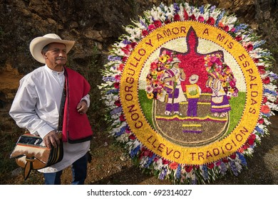 August 7, 2017 Medellin, Colombia: a farmer is posing with his floral display made for the annual flower festival parade
