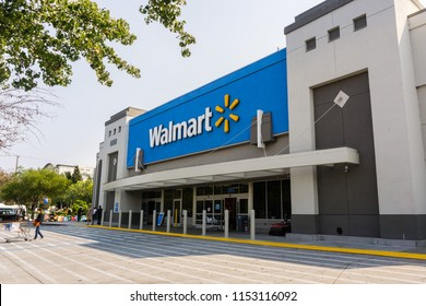 August 7, 2018 Mountain View / CA / USA - People going in and coming out of a Walmart store on a sunny day, south San Francisco bay area