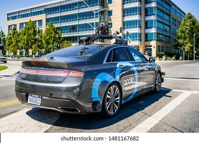 August 7, 2019 Sunnyvale / CA / USA - Apollo project vehicle equipped with a roof-mounted mobile mapping unit driving on the streets of Silicon Valley;  Apollo project (Apolong) was launched by Baidu