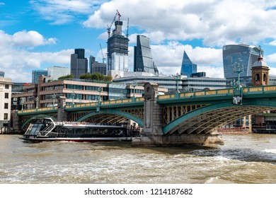 August 8, 2018, London, United Kingdom.  Southwark bridge. The central area of modern high-rise buildings on the banks of the Thames is a symbol of the new London.