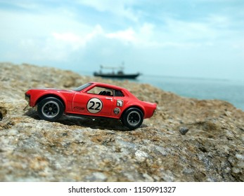 August 8, 2018-Ipoh, Malaysia. a hotwheel car was captured by a hobbyist near the beach in Malaysia. Selectively focus.