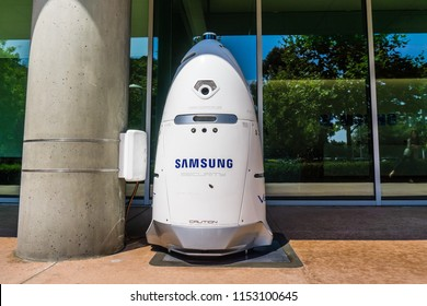 August 9, 2018 Mountain View / CA / USA - Knightscope security robot branded with the Samsung logo docked outside one of the buildings in the Samsung Research America campus, Silicon Valley