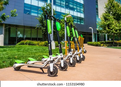 August 9, 2018 Mountain View / CA / USA - Lime Scooters lined up at the LimeHub in the Samsung campus in Silicon Valley, south San Francisco bay area