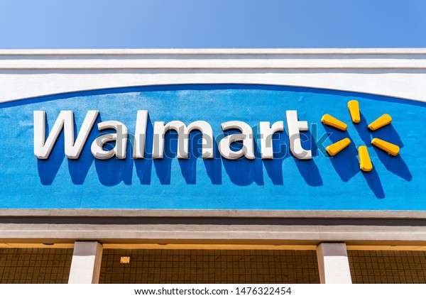 August 9, 2019 San Jose / CA / USA - Close up of Walmart logo displayed on the facade of one of their supercenters in South San Francisco bay area