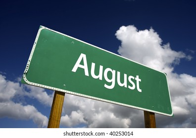 August Green Road Sign with dramatic blue sky and clouds - Months of the Year Series.