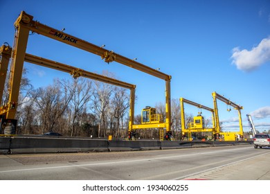 Augusta, Ga USA - 02 07 21: Huge Heavy industrial road machines and cranes on a bridge construction site top copyspcae yellow structure