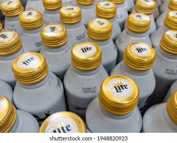 AUGUSTA, GEORGIA - APRIL 2, 2021 : Miller Lite aluminum beer bottles on grocery store display. Miller Lite is one of the top selling domestic beers in the United States.