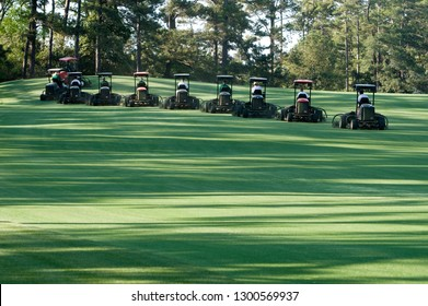 Augusta, Georgia / United States - April 2010:  Groundskeepers at Augusta National performing synchronized mowing and golf course maintenance activities