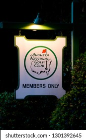 Augusta, Georgia/United States:    Members Only sign outside the Magnolia Lane and Washington Road entrance of Augusta National Golf Club taken during the night, illuminated with a green lamp.