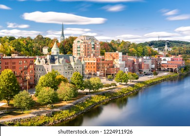 Augusta skyline on a sunny afternoon (long exposure for smooth sky and water). Augusta is the state capital of the U.S. state of Maine and the county seat of Kennebec County